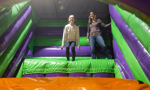 Young girl getting ready to bounce at the airbag jump base.