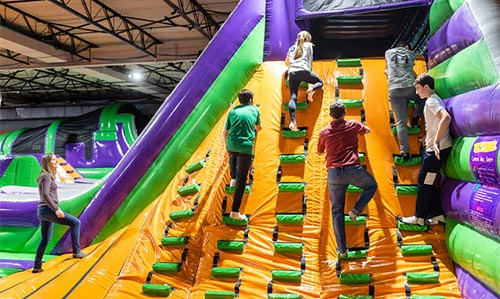 Climbing up the soft inflatable indoor jump park in Woburn Massachusetts