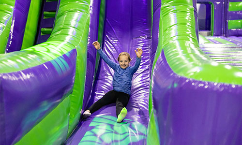 Young girl slinding in Woburn MA jump park