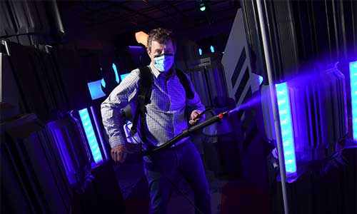 Disinfecting the laser tag arena.