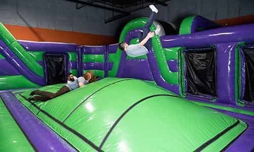Hopping on the obstacle course at the inflatable air park at XtremeCraze