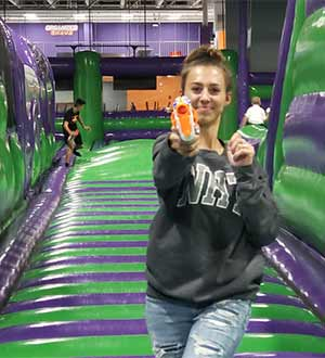Teenager enjoying a game of nerf balls at the Airpark in Londonderry NH