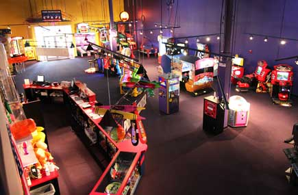 Adults enjoy the arcade games in the GameZone too!