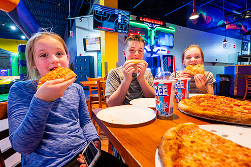 Enjoy fresh baked pizza and refreshing soft drinks at group events at XtremeCraze