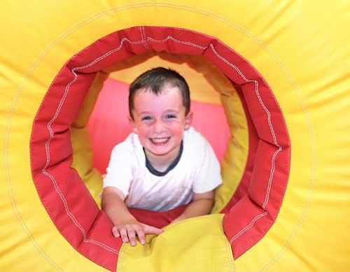 Enjoying the inflatable children's slide